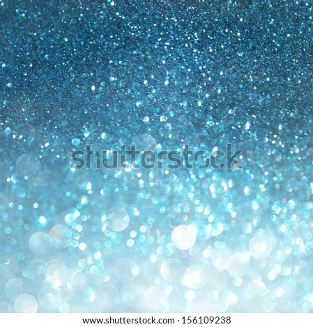 abstract blue bokeh lights, defocused background of blue and white lights. - stock photo