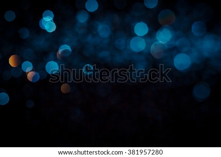 Abstract blue bokeh  texture on black background