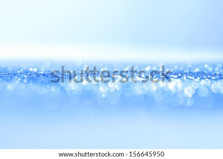 Abstract blue bright sparkles defocused background - stock photo