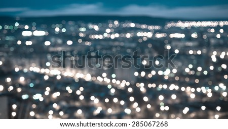 abstract blue circular bokeh background, city lights in the twilight with horizon, panorama - stock photo