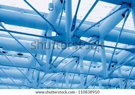Abstract blue geometric ceiling in office center - stock photo