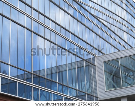 Abstract blue glass facade of modern business center building - stock photo