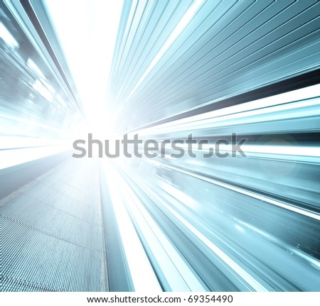 abstract blue high-speed moving escalator leading to light