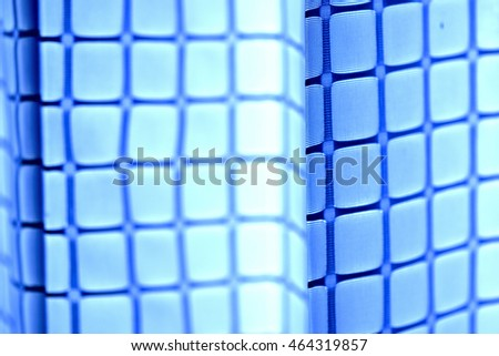 Abstract blue mesh curtain or drape and selective focus.