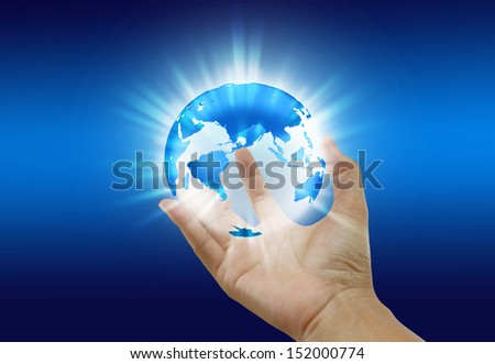 Abstract, blue planet earth in hand