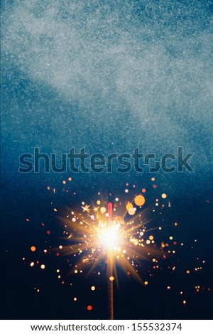 abstract blue shiny background with sparkler - stock photo