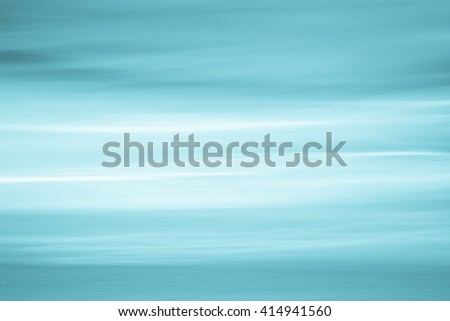 Abstract blue sky and ocean, nature background with blurred panning motion. - stock photo