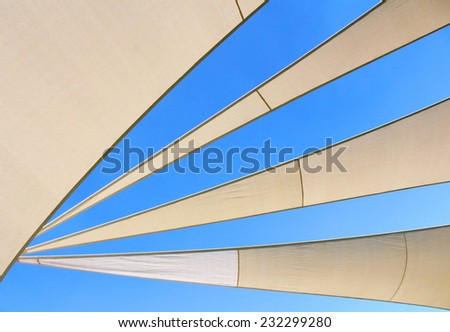 abstract blue sky and tent background. blue sky photo background, white stripes on the blue sky. - stock photo