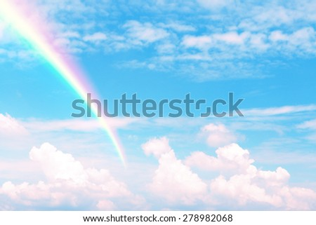 Abstract blue sky white cloud for background with rainbow - stock photo