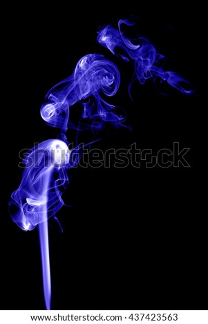 Abstract blue smoke on black background from the incense sticks