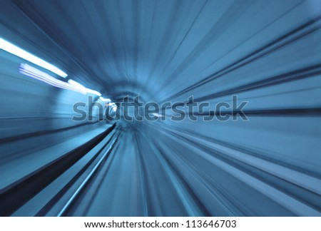 Abstract blue tunnel with motion blur at high speed
