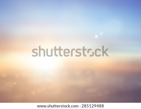 Abstract blur aerial view Bangkok city skyline sunrise, circle bokeh background. Beautiful light of hope from heaven, International Mountain Day, Spiritual concept. Orange brown blue color pattern. - stock photo
