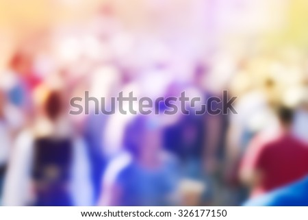 Abstract blur audience crowd of people at public outdoors place or gathering, social event background, vivid colors, defocus image. - stock photo