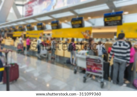 Abstract Blur Background : Airport Check-In Counters With Passengers And Crowd Control Barriers With Bokeh,The public check-in area - stock photo