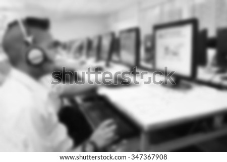 Abstract blur background boy student use computer in school computer room. Network communication for education. Student using computer in learning and teaching.