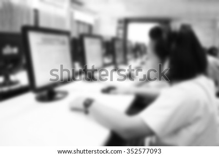 Abstract blur background girl student use computer in school computer room. Network communication for education. Student using computer in learning and teaching. class exam study business.