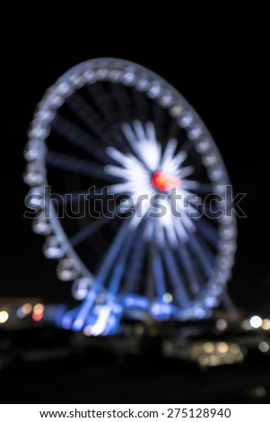 Abstract blur background of Ferris wheel at night - stock photo