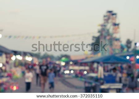 abstract blur background of people shopping at market fair, vintage toning - stock photo