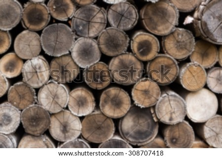 Abstract blur background of stacked timber logs. - stock photo