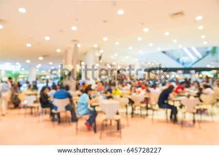 Restaurant Background With People blurred background of people inside fast food restaurants stock
