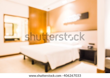 Abstract blur Beautiful luxury White pillow on bed and light lamp on wall decoration in bedroom interior - Vintage Light Filter