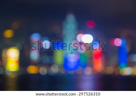 Abstract blur bokeh light of Hong Kong city water fronts at night  - stock photo