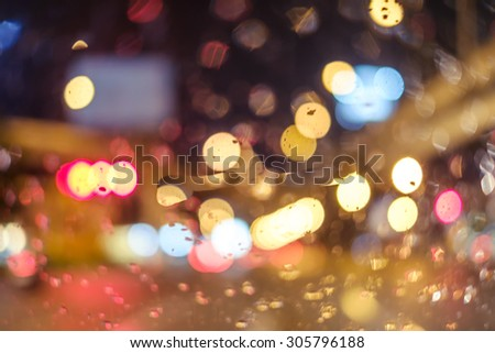Abstract blur bokeh of traffic and car light on  the road in the city while raining - stock photo