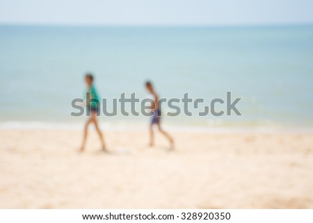Abstract blur boy and girl walking on the beautiful beach