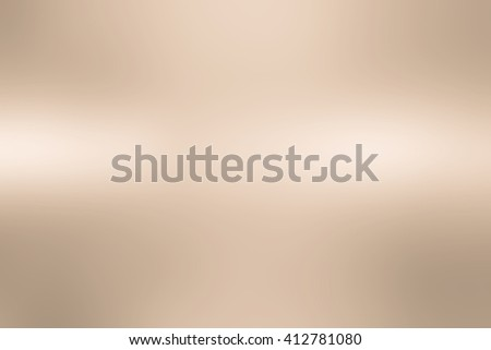 abstract blur bright gold tan bronze alloy metallic surface background concept:blurry sparkle shine backdrop:blurred gradient metal light wallpaper conceptual:christmas festive and happy new year card - stock photo