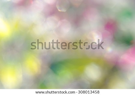 Abstract blur bright iridescent bokeh background - stock photo