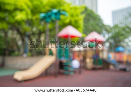 Abstract blur children playground in city park background - stock photo