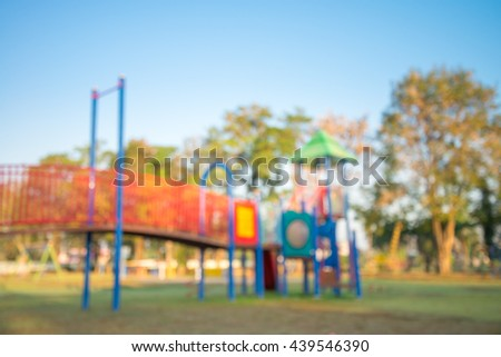 Abstract blur children playground in city park background in morning - stock photo