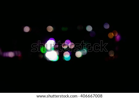 abstract blur circular bokeh color of Evening traffic jam on road in city.