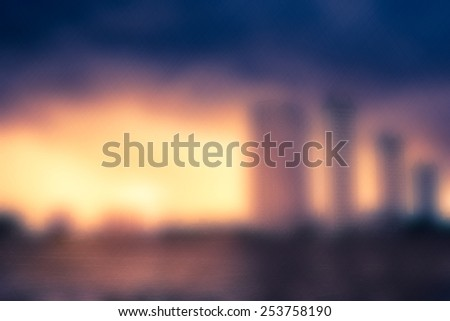Abstract blur, cityscape river view at twilight time - stock photo