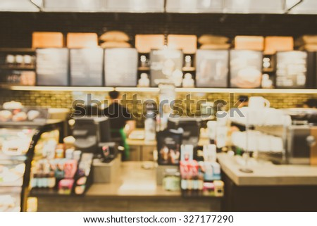 Abstract blur coffee shop cafe interior background - vintage filter
