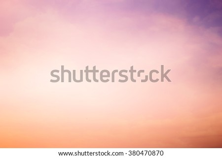 abstract blur color sunset backgrounds with shiny lens flare light:blurry soft of pink and purple colored in vintage tone:blurred natural backdrop concept:blur of pastel color with shine conceptual. - stock photo
