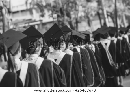 Abstract blur Crowd image of students at graduation ceremony from behind - stock photo