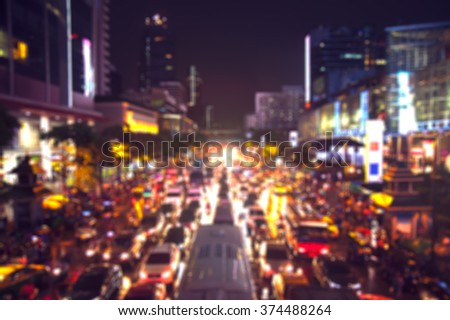 Abstract blur Crowd of vehicles stand in a traffic jam after work in downtown bangkok - stock photo
