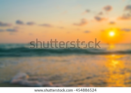Abstract blur Feet on the sand in sunset time Sunset over the Sea - stock photo