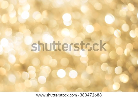 abstract blur gold bronze background concept:blurry soft glittering ball shine backdrop:blurred golden gradient sparkling bokeh light wallpaper conceptual:christmas festive and happy new year card. - stock photo