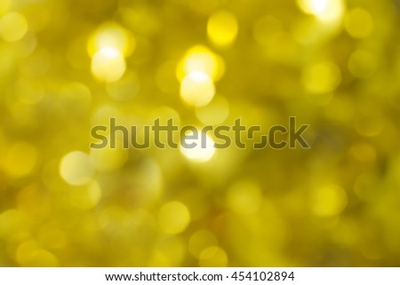 abstract blur gold bronze background concept:blurry soft glittering ball shine backdrop:blurred golden gradient sparkling bokeh light wallpaper conceptual:christmas festive and happy new year card.