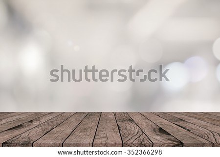 abstract blur grey and sepia tone colored with grunge aged wood striped perspective background:blurry brighten soft silver gray color backdrop with veneer panel plank.advertising products on display - stock photo