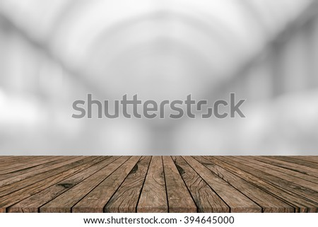 abstract blur grey tone color with grunge aged old wood panels striped perspective background:blurry brighten soft silver gray color backdrop with veneer panel plank.advertising products on display - stock photo