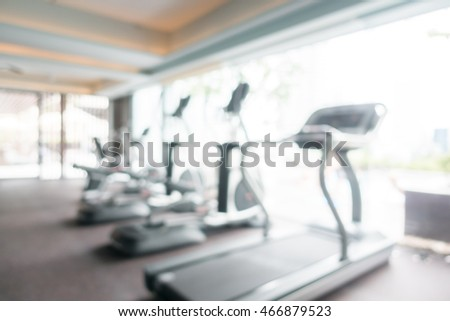 Abstract blur gym and fitness room interior for background