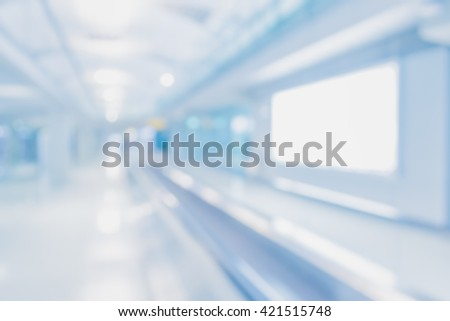 abstract blur image of long corridor in subway with people for background usage . - stock photo