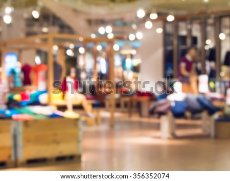 Abstract blur jeans shop in the mall shopping centre. - stock photo