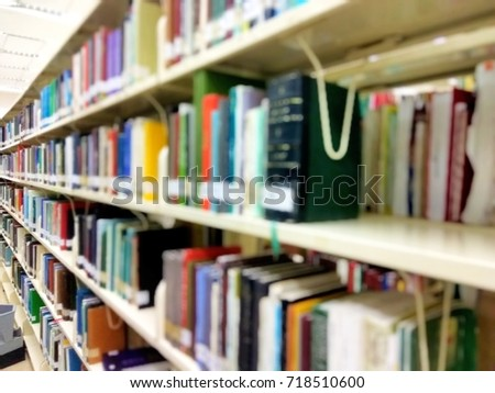 Abstract blur library in university setting with books and reading material on shelves.