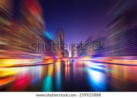 Abstract blur modern cityscape background at night - stock photo