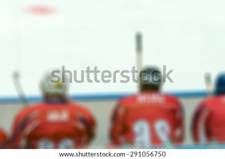 Abstract blur of ice hockey players at tournament play. Bokeh background - stock photo