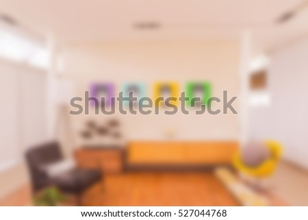 Abstract blur of living room wall with pictures on wall can be used as background images